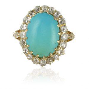 Bague ancienne turquoise cabochon et diamants.