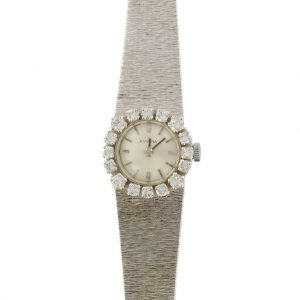 Montre vintage or blanc diamants femme.