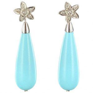 Boucles d'oreilles diamants et goutte turquoise.