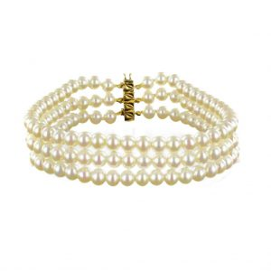 Bracelet 3 rangs de perles.