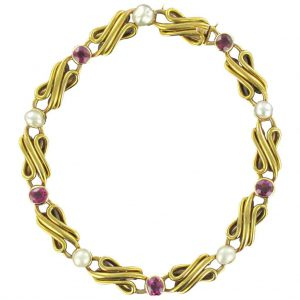 Bracelet ancien ligne rubis perles fines.