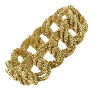 Bracelet en or tresses.